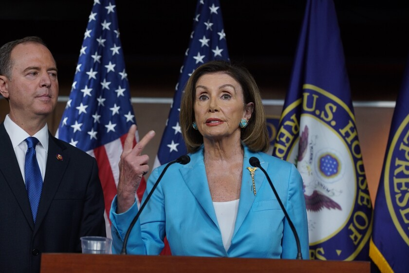 House Speaker Nancy Pelosi (D-San Francisco) at a recent news conference discussing the impeachment inquiry, along with Intelligence Committee Chairman Rep. Adam B. Schiff (D-Burbank).
