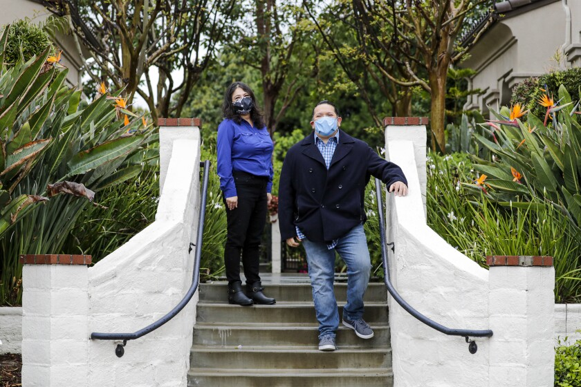 El Monte couple Rosalina Nava and Danny Herrera were initially resistant to wearing face masks.