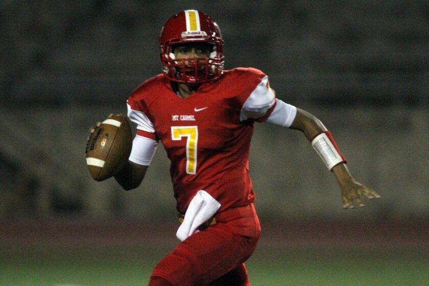 Mt. Carmel quarterback Lucas Johnson has had a hand in 12 touchdowns for the Sundevils this season.