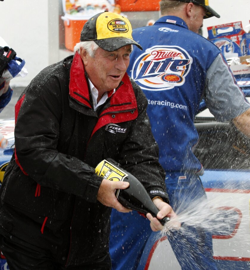 FILE - In this Aug. 21, 2007, file photo, team owner Roger Penske celebrates Kurt Busch's victory at the NASCAR Nextel Cup 3M Performance 400 auto race at Michigan International Speedway in Brooklyn, Mich. With all the hoopla surrounding the 100th Indianapolis 500, Roger Penske has a celebration of