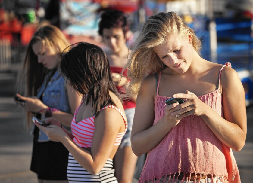 Head bowed over a cellphone while texting for long periods of time is a posture that can eventually lead to spinal disk damage.
