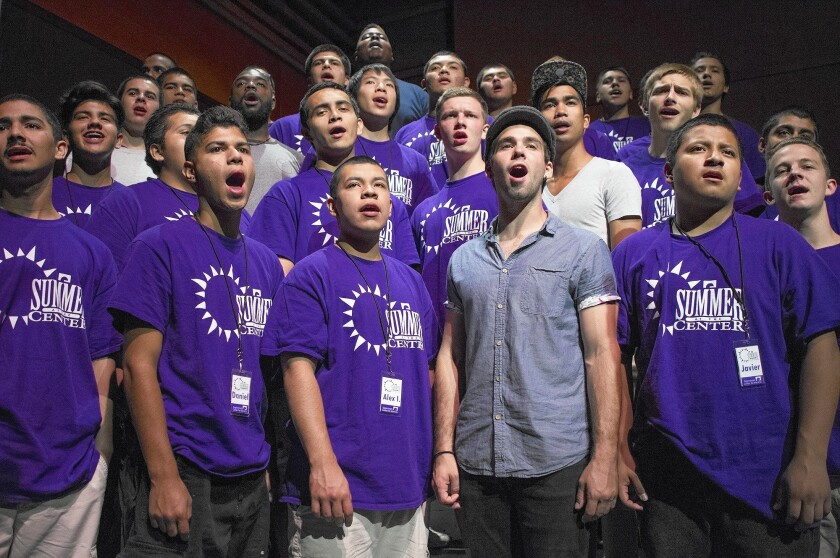 """Teens from Orange County and staff members rehearse a theme song from the film """"The Sound of Music"""" during a Summer at the Center program on Wednesday in the Samueli Theatre at Segerstrom Center for the Arts in Costa Mesa."""
