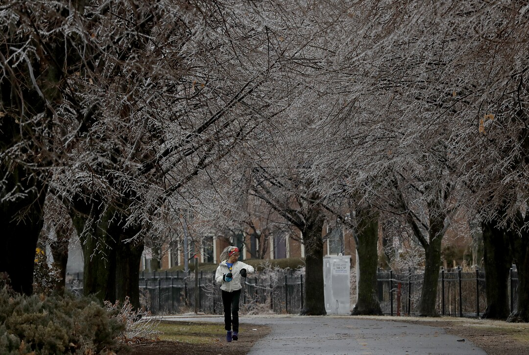 A jogger runs under frosted trees in the Burlington Waterfront Park and Promenade on the shores of Lake Champlain. Presidential candidate and U.S. Sen. Bernie Sanders led a push to restore and preserve the area for public use when he was the city's mayor in the 1980s.