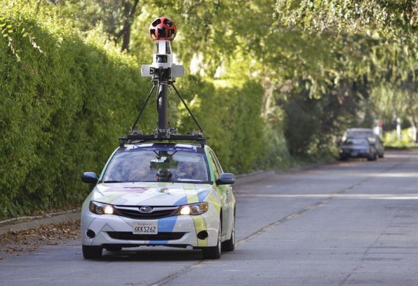 A Google employee drives a Street View car around Palo Alto, Calif.