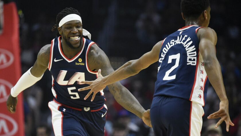 Los Angeles Clippers forward Montrezl Harrell, left, celebrates with guard Shai Gilgeous-Alexander a