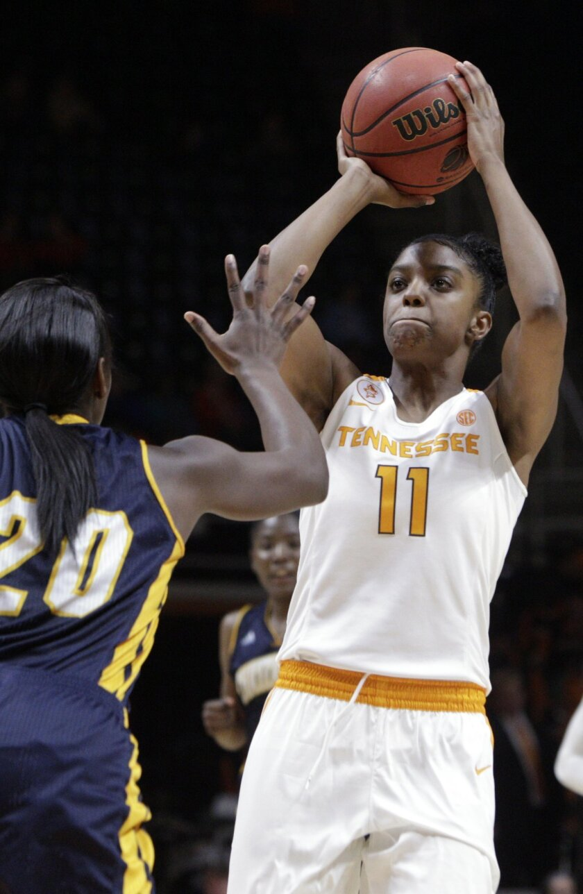 Tennessee guard Diamond DeShields (11) shoots past Chattanooga guard/forward Keiana Gilbert (20) in the first half of an NCAA college basketball game Monday, Nov. 23, 2015, in Knoxville, Tenn. (AP Photo/Wade Payne)