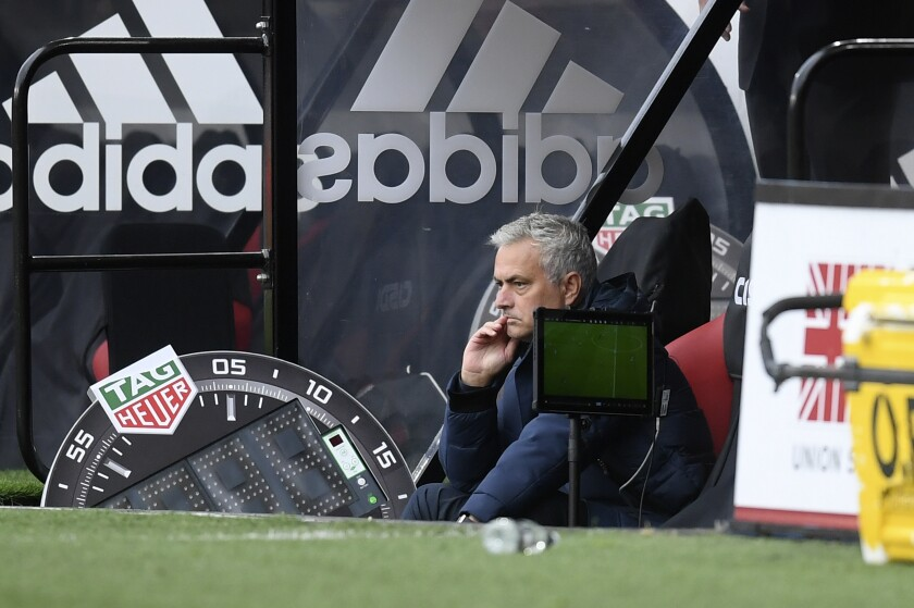 Tottenham's manager Jose Mourinho watches his players during the English Premier League soccer match between Sheffield United and Tottenham Hotspur at Bramall Lane in Sheffield, England, Thursday, July 2, 2020. (Michael Regan/Pool via AP)