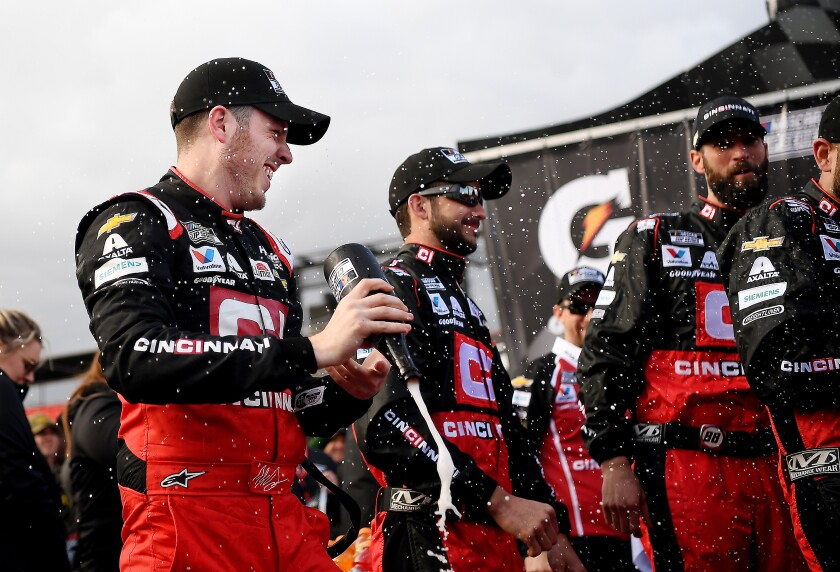 NASCAR driver Alex Bowman celebrates with his crew after winning the Auto Club 400 at Auto Club Speedway in Fontana on Sunday.