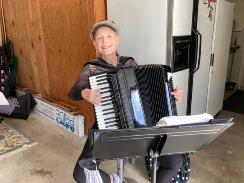 La Jolla resident Vicki Eriqat plays accordion in three groups after working 30 years as an attorney.