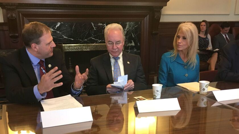 Secretary of Health and Human Services Tom Price, center, meeting with New Hampshire Gov. Chris Sununu and White House advisor Kellyanne Conway last month for a discussion of the state's opioid crisis.