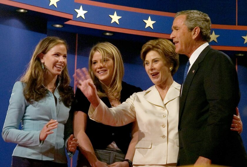 The family of US President George W Bush join him on the podium after the first Presidential Debate