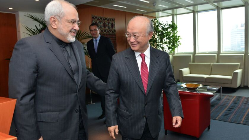 IAEA Director General Yukiya Amano, right, met with Iranian Foreign Minister Mohammad Javad Zarif at