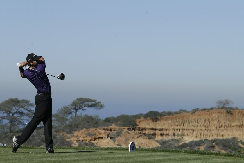 Jason Day, of Australia, hits his tee shot on the 13th hole of the North Course at Torrey Pines during the second round of the Farmers Insurance Open golf tournament Friday, Feb. 6, 2015, in San Diego. (AP Photo/Gregory Bull)