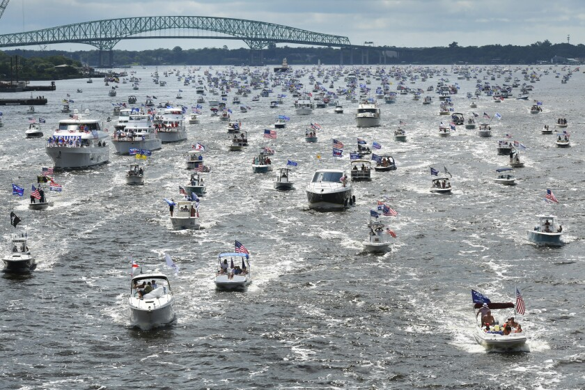 Boats idle on the St. Johns River in Jacksonville, Fla., during a rally Sunday to celebrate President Trump's birthday.