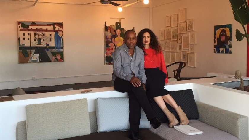 Painter Henry Taylor at his namesake gallery space during the debut exhibition with Jessica Ayromloo, who helped design the gallery area.
