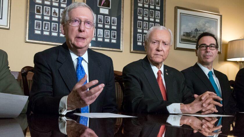 From left, Senate Majority Leader Mitch McConnell (R-Ky.), Senate Finance Committee Chairman Orrin Hatch (R-Utah) and Treasury Secretary Steven T. Mnuchin, talk about the Senate's tax bill at the U.S. Capitol on Thursday.