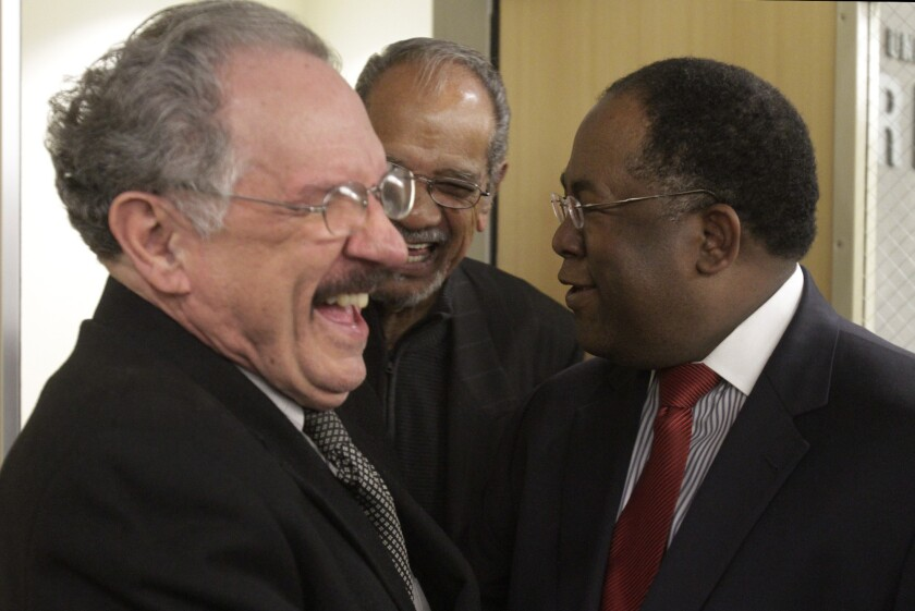 George McKenna, left, shown with community activist Larry Aubry, center, and Los Angeles County Supervisor Mark Ridley-Thomas in January, will face no opposition in March in his bid to remain on the L.A. school board.