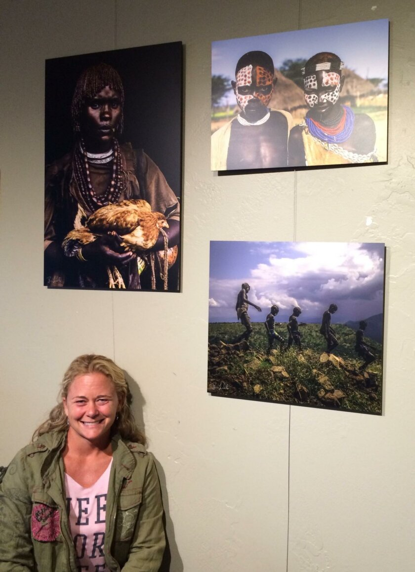 Briana Gallo with her photos of Ethiopian villagers.