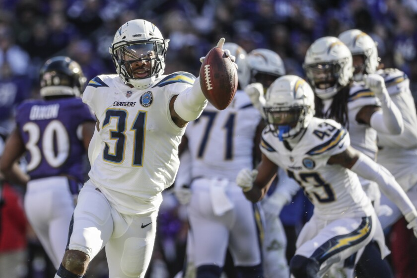 Chargers safety Adrian Phillips celebrates after intercepting against the Baltimore Ravens last season.