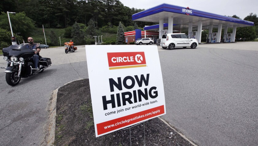 """In this June 20, 2018, photo, a """"Now Hiring"""" sign is posted outside a gas station in Raymond, N.H. O"""