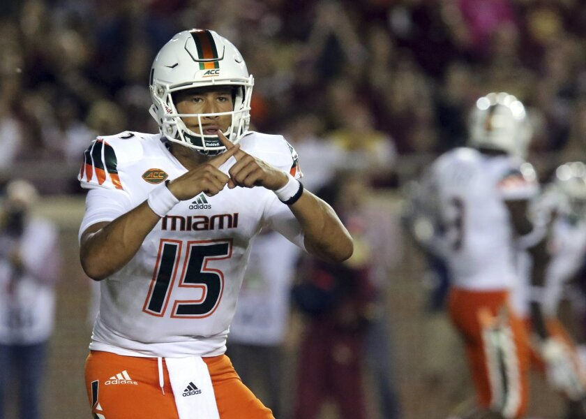 FILE - In this Oct. 10, 2015, file photo, Miami quarterback Brad Kaaya calls a play during an NCAA college football game against Florida State in Tallahassee, Fla. The Hurricanes have new coach in Mark Richt and are a decade removed from their last bowl win, but possess a bona fide star in Kaaya–a