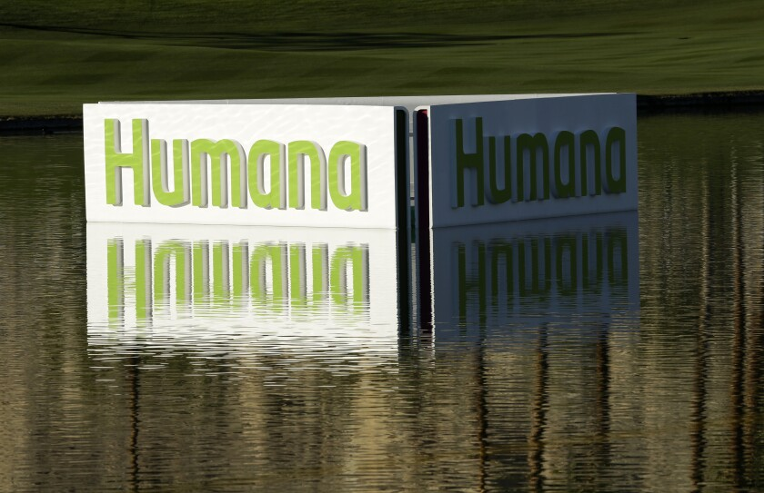 """FILE - A Humana logo is seen in a lake on the Palmer Private Course at PGA West during the first round of the Humana Challenge PGA golf tournament in La Quinta, Calif., in this Thursday, Jan. 17, 2013, file photo. Surging COVID-19 cases are blurring the view for health insurers of how 2021 will play out. Medicare Advantage coverage specialist Humana said Wednesday, July 28, 2021, that it was maintaining its 2021 earnings forecast, citing """"heightened uncertainty"""" about the ongoing pandemic. (AP Photo/Ben Margot, File)"""