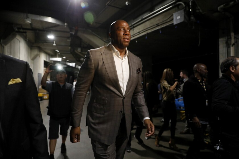 Magic Johnson walks away immediately after announcing his resignation as the Lakers' president of basketball operations in April.