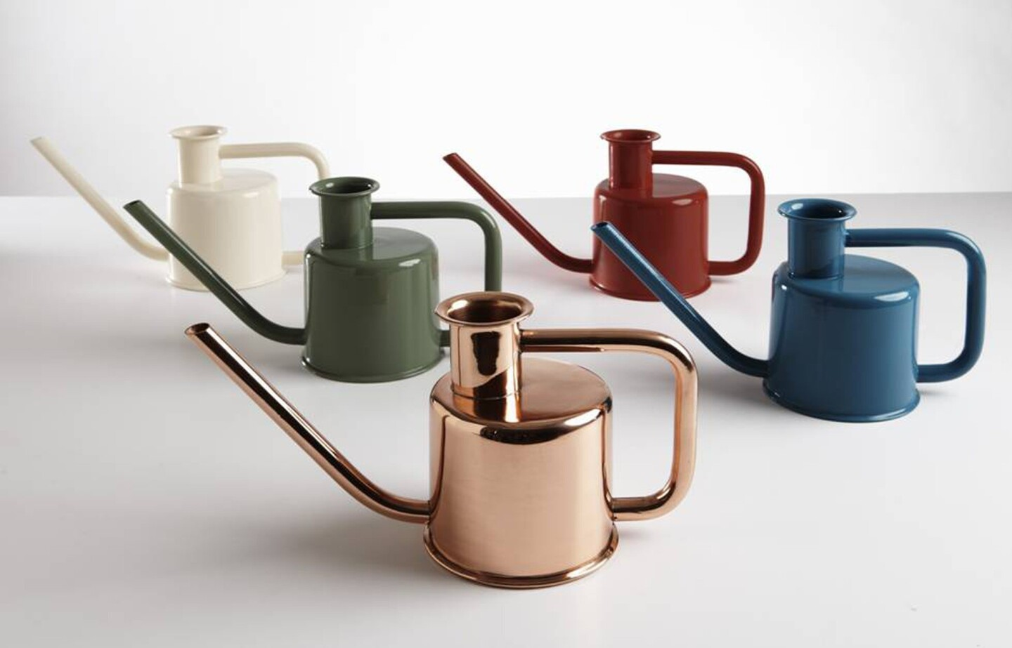 Kontextür, the design firm behind the X3 metal watering can by Paul Loebach, touts not only the aesthetics but also the function of the new design: The right angles in the handle provide one easy grip for watering and another easy grip for carrying. The white, green, red and blue cans are $49 through the Kontextür store, and the copper ...