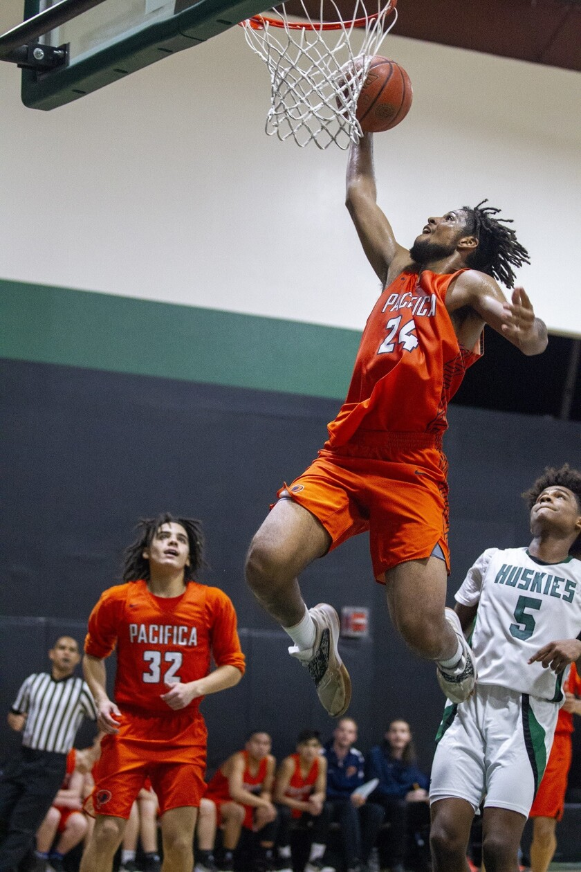 Pacifica Christian Orange County High's Josh Sims goes up for a dunk in a CIF State Southern California Regional Division III quarterfinal playoff game at Fairmont Prep on Thursday.