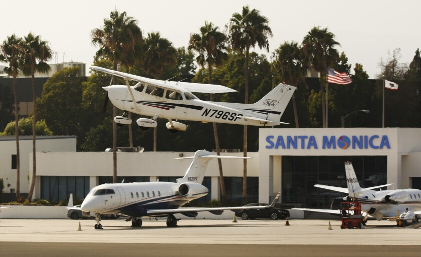 A private plane takes off from Santa Monica Municipal Airport.