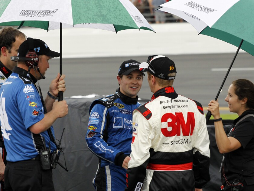Ricky Stenhouse Jr., left, talks with Greg Biffle during a rain delay at the Daytona 500 on Sunday.