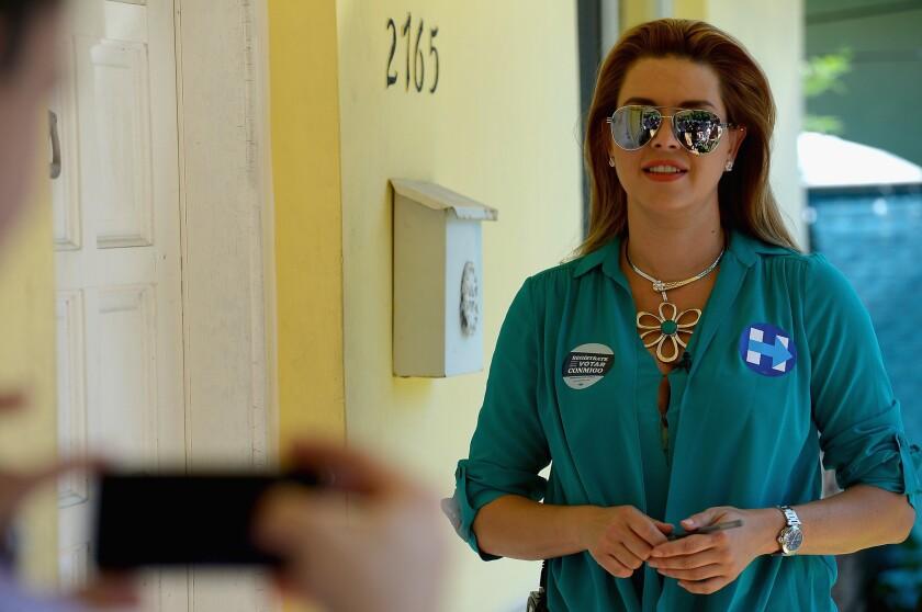 Former Miss Universe Alicia Machado campaigns for Hillary Clinton in Miami, Fla., in August.