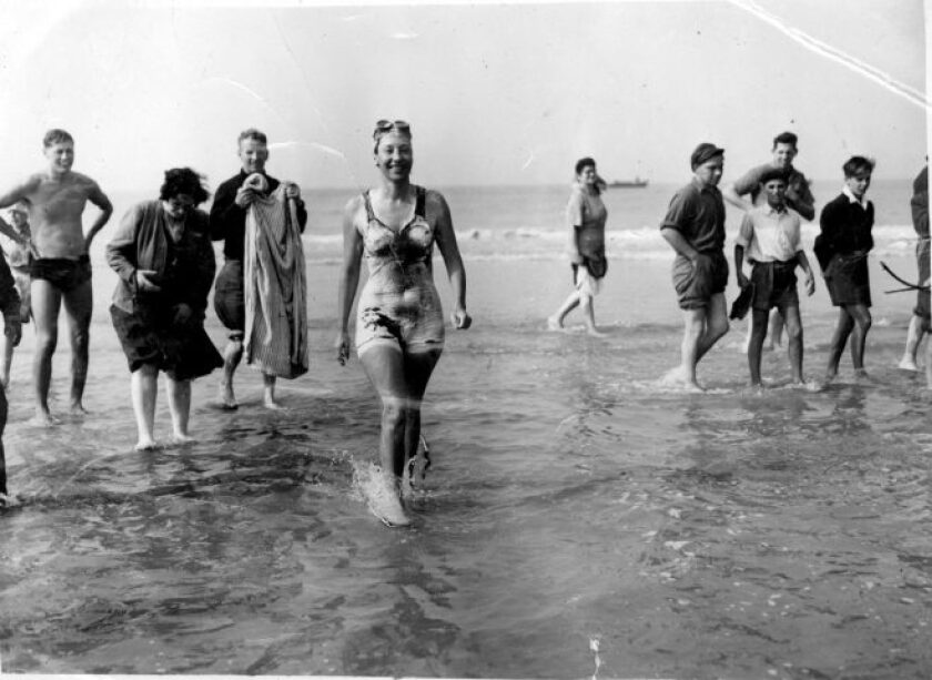 Long-distance swimmer Florence Chadwick wades ashore at Dover, England, after setting the women's speed record for crossing the English Channel on Oct. 12, 1950. The late San Diego native is the inspiration for The Florence, a new restaurant/bar that opened March 25 in Sabre Springs.