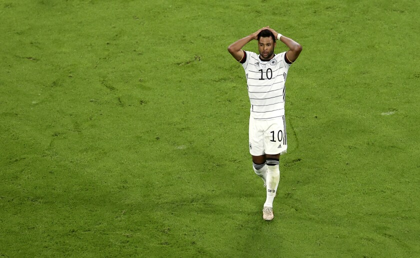 Germany's Serge Gnabry reacts after he failed to score during the Euro 2020 soccer championship group F match between France and Germany at the Allianz Arena stadium in Munich, Tuesday, June 15, 2021. (AP Photo/Alexander Hassenstein, Pool)
