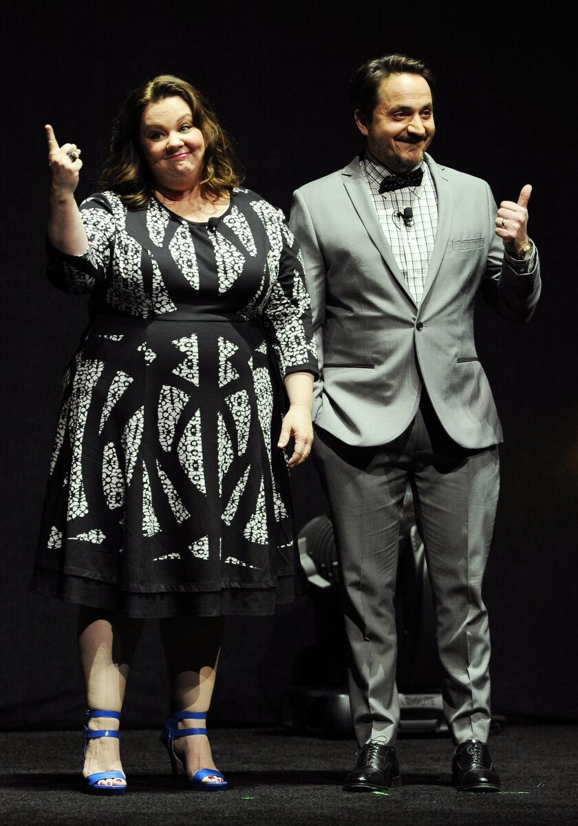 "Melissa McCarthy, left, a cast member in the upcoming film ""Tammy,"" and her husband Ben Falcone, writer and director of the film, address the audience during the Warner Bros. presentation at CinemaCon 2014 on Thursday, March 27, 2014, in Las Vegas. (Photo by Chris Pizzello/Invision/AP)"