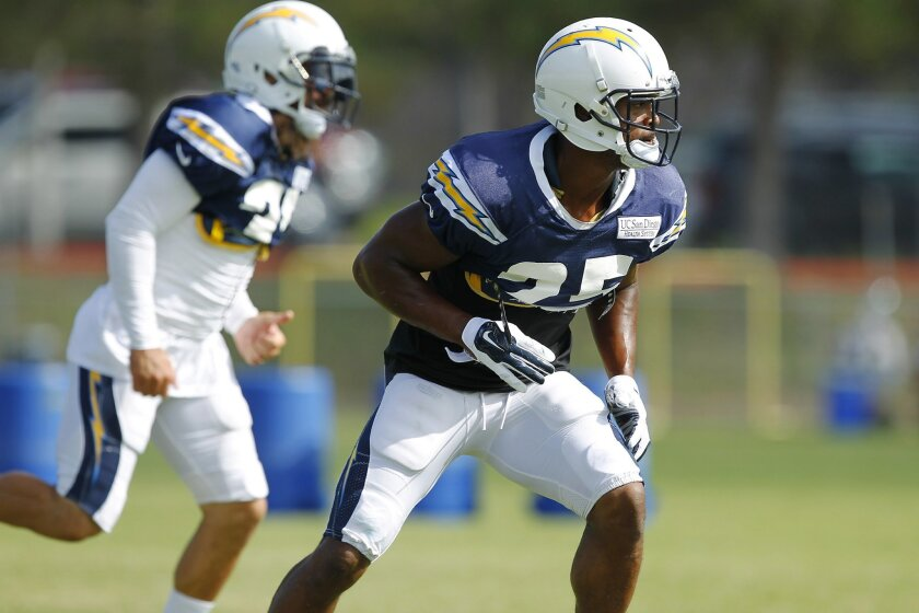 Chargers Darrell Stuckey runs a drill during practice.