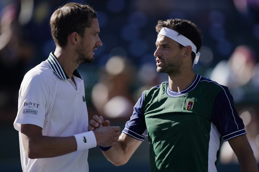 Grigor Dimitrov shaking hands with Daniil Medvedev after the match.
