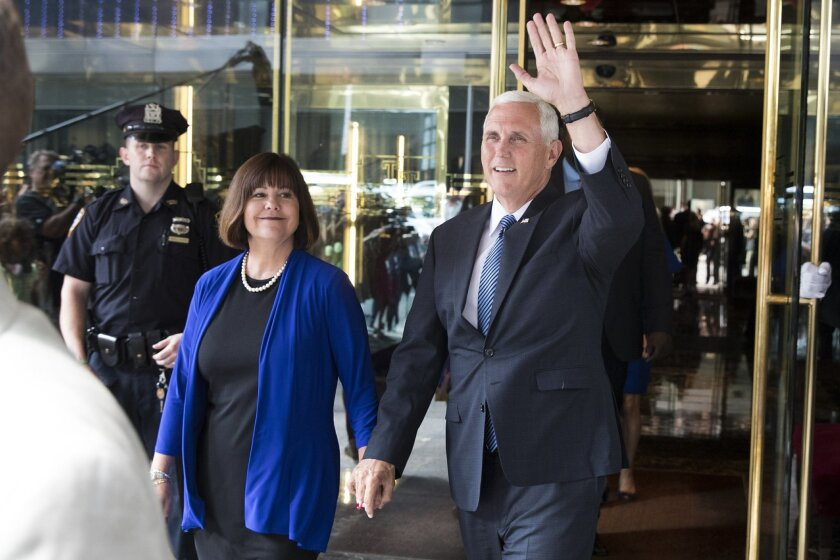 Indiana Gov. Mike Pence, accompanied by his wife Karen, waves as they leave a meeting with Republican presidential candidate Donald Trump at Trump Tower in New York, Friday, July 15, 2016. (AP Photo/Evan Vucci)