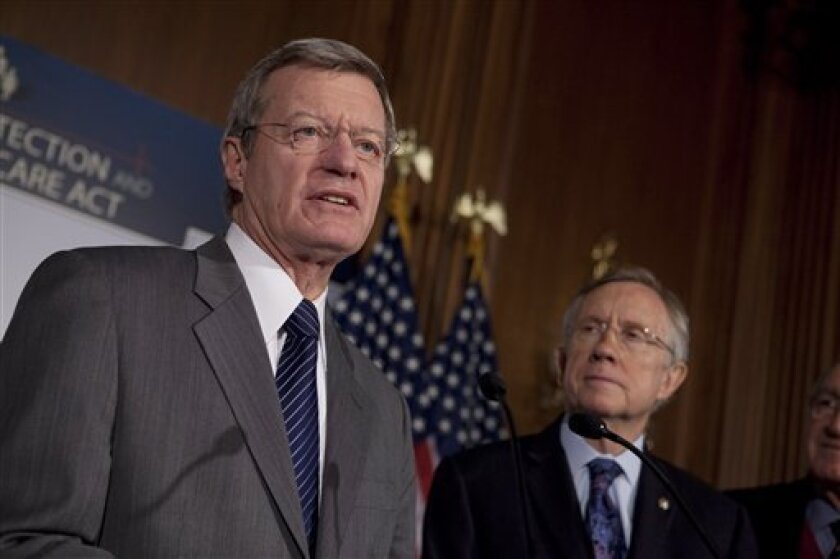 FILE - In this Dec. 21, 2009, file photo, Senate Majority Leader Harry Reid of Nev., right, looks on as Senate Finance Committee Chairman Sen. Max Baucus, D-Mont. speaks on Capitol Hill in Washington. Democrats say they never saw it coming, but the breakdown of President Barack Obama's health care overhaul was abetted by their own mistakes. (AP Photo/Evan Vucci, File)