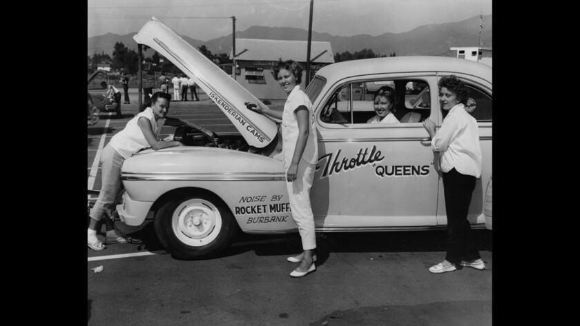 Members of the Throttle Queens prepare the club coupe for a drag race.