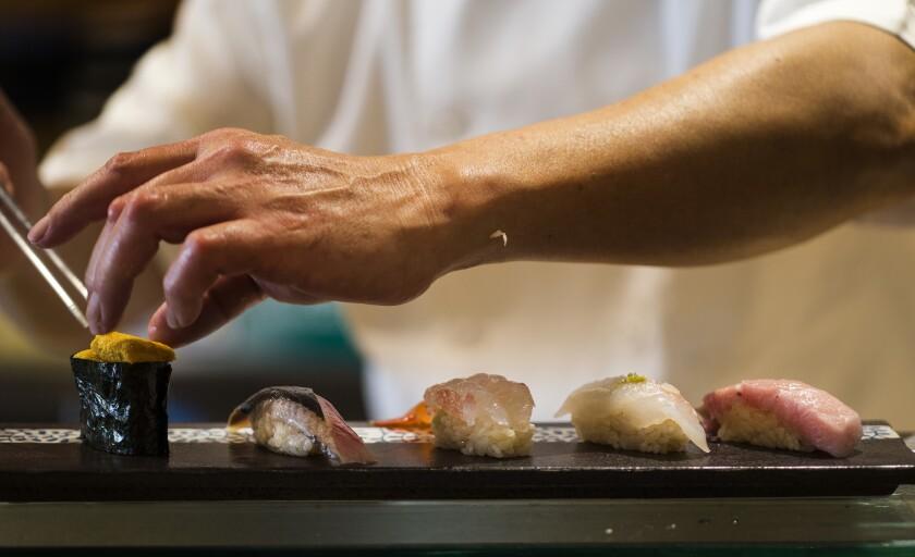 Chef Yutaka Kudo prepares the chef's special sushi plate at Osawa in Pasadena.