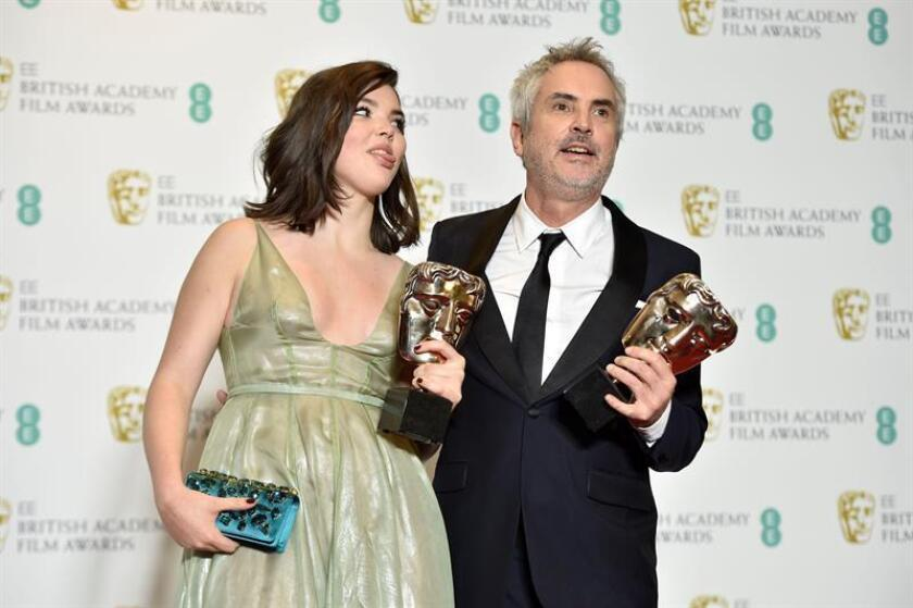 Mexican director Alfonso Cuaron (R) and his daughter Tessa pose with the awards for Best Film and Best Director for 'Roma' in the press room during the 72nd annual British Academy Film Awards at the Royal Albert Hall in London, Britain. EFE/Archivo
