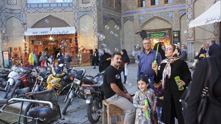 Iran - Isfahan (Esfahan), capital of the province of the same name, evening scene at the entrance to