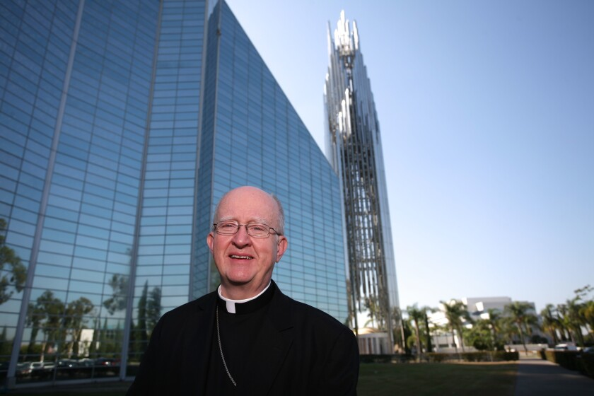 Bishop Kevin Vann in front of Christ Cathedral in Garden Grove.