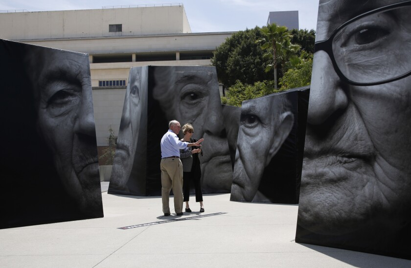 Visitors take in the 'iwitness' public art installation