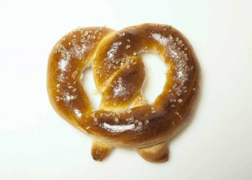 A warm pretzel right out of the oven is a grand thing. Pictured is a soft pretzel. Recipe