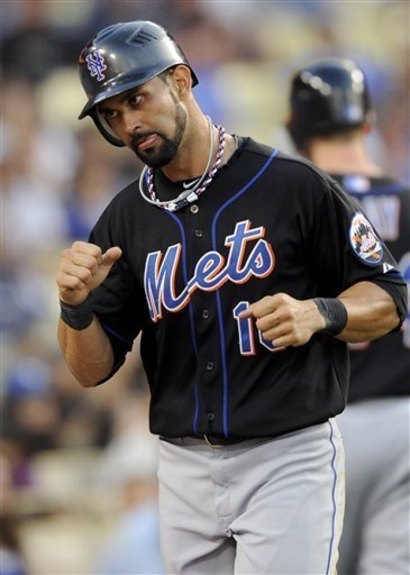 New York Mets' Angel Pagan celebrates after scoring on Carlos Beltran's double to right in the sixth inning of a baseball game against the Los Angeles Dodgers, Monday, July 4, 2011, in Los Angeles. (AP Photo/Gus Ruelas)