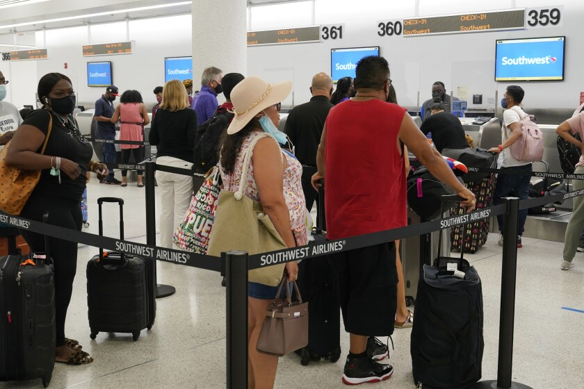 Airline passengers lining up to check in