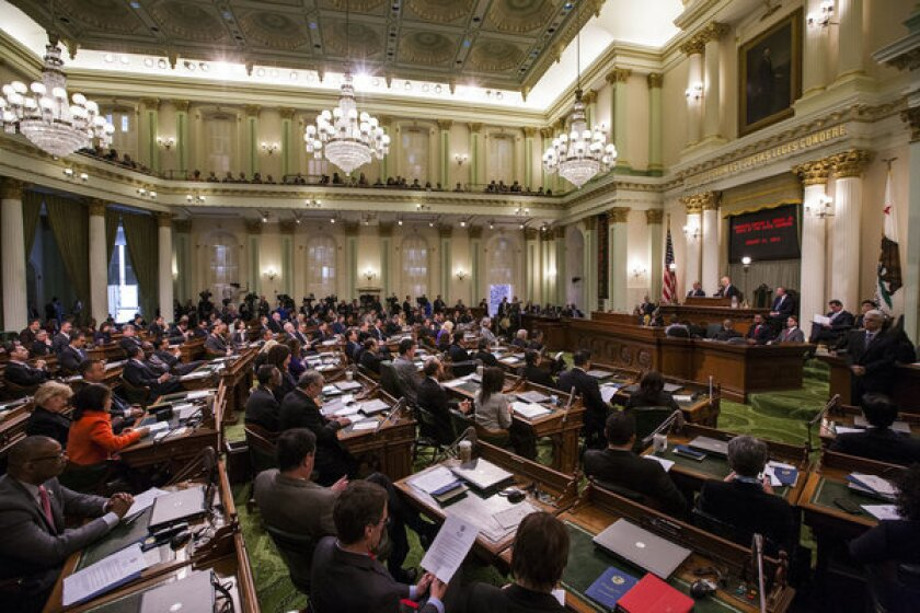 California lawmakers face a lengthy to-do list that includes gun control and immigration. Here, Gov. Jerry Brown addresses the legislature in January.