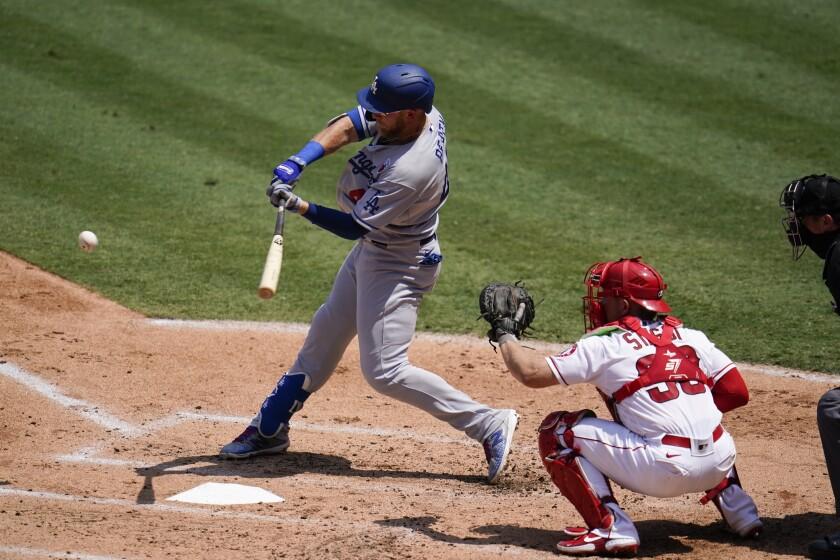 Dodgers first baseman Matt Beaty hits against the Angels.